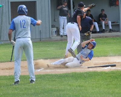 Caden Opheim safely slid into home as the Wolves took an early lead over Hill City-Northland.