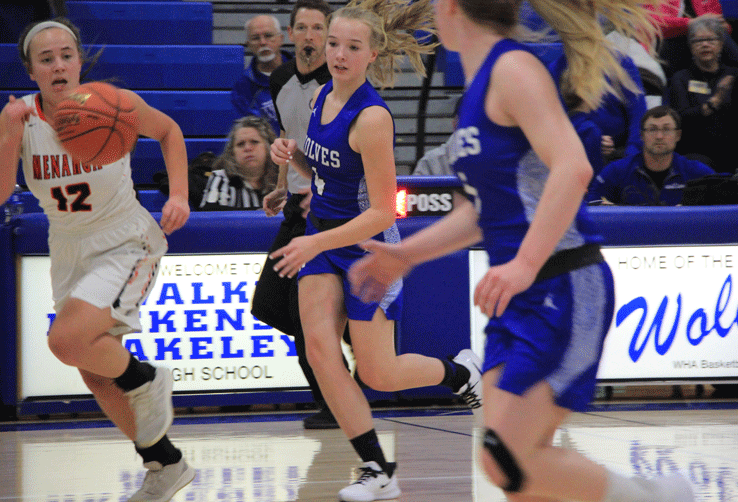 Emma Deegan (center) feeds the ball to Ally Sea on this fast-break play that resulted in a lay up for Sea.