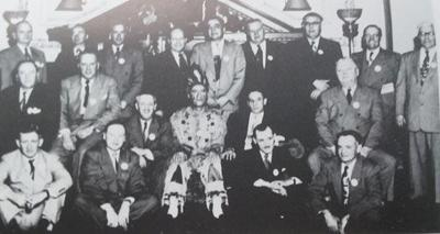 Milt Uglum (front center) dressed in traditional Native-American garb along with the men of the Walker Lions Club.