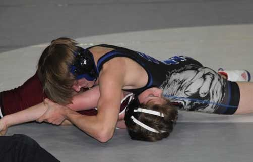 Dylan Johnson pins Koltyn Larson of Fosston-Bagley in the second period of the 106-pound match.