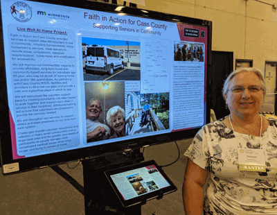 Executive Director Theresa Eclov with the Faith in Action Poster Presentation at the 2019 Odyssey Conference in Duluth.