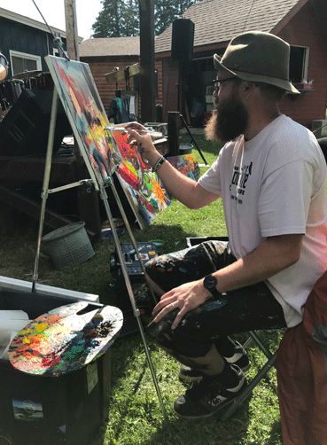Nate Luetgers, a Park Rapids area artist, is often seen painting in the community at public events, such as at Nevis Sites and Bites. He teaches art classes to all ages and will be teaching two free art classes for youth at the Nemeth Art Center this summer.