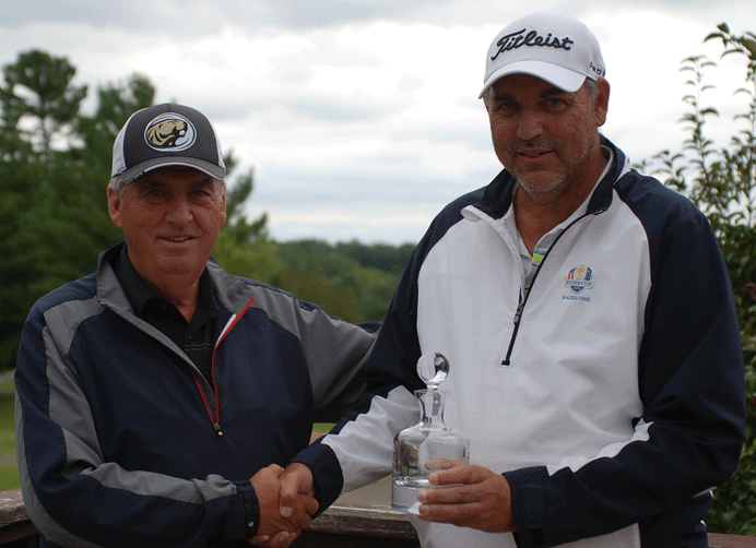 Greg Mattson (right), who took first in the Senior Championship, receives his prize from Ray Sauer.