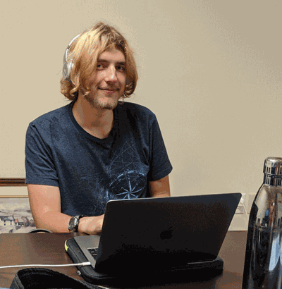 New nonprofit media intern Paul Espeland at work at Faith in Action.