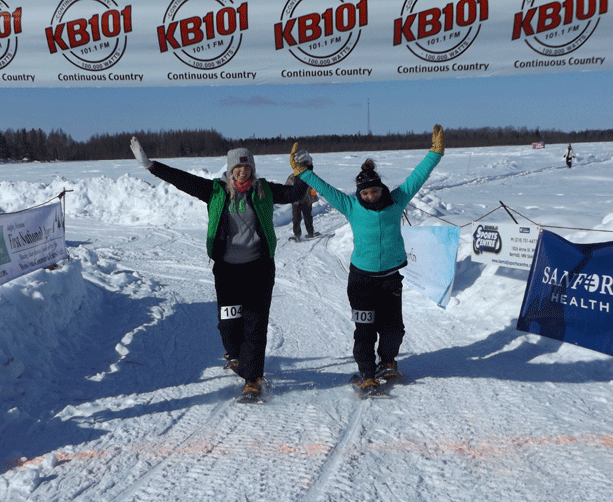 Michelle Hubbard and Mindy Cowell at the 5K finish line.