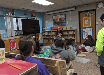 Author Michael Bazzett visited Bug-O-Nay-Ge-Shig School last week and read to some of the students.