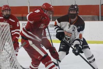 The Panthers' Jack Slagle (right) battles for a loose puck in a game with Detroit Lakes last week.