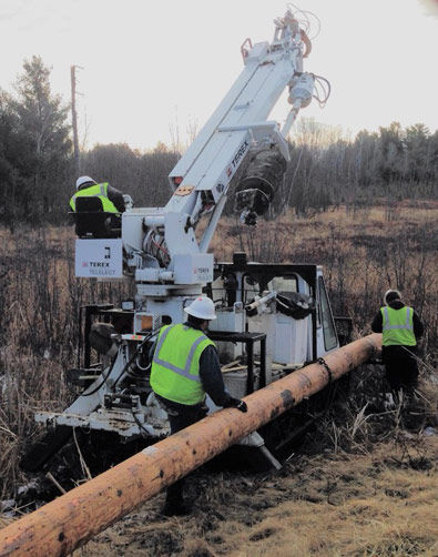 A crew from Lake Country Power put an osprey nest platform on a new pole.