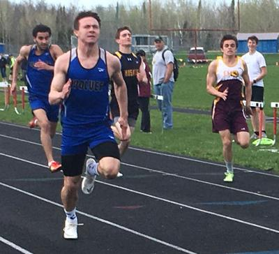 Tyler Sea sprints to the finish line to take first place in the 100-meter dash.