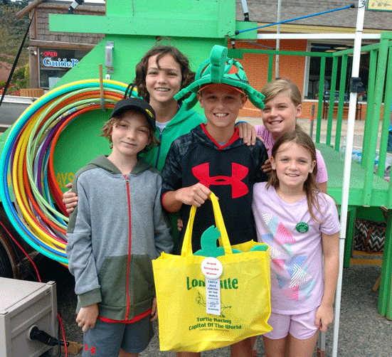 Slowpoke winner 13-year-old Logan Peroutka of Faribault with his siblings.