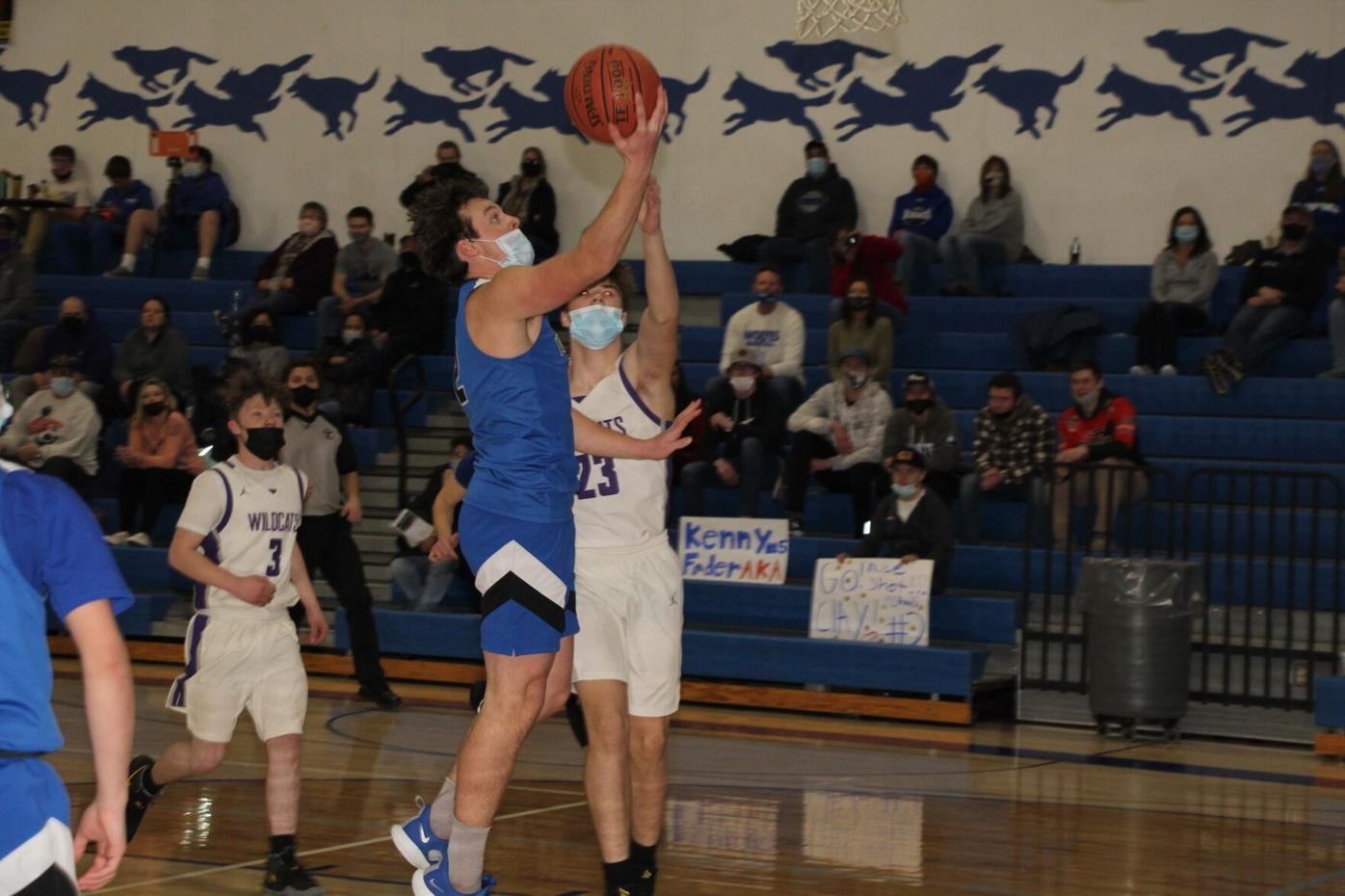 Clay Nelson scores two of his season-high 43 points in the Wolves' 85-24 win over Laporte.