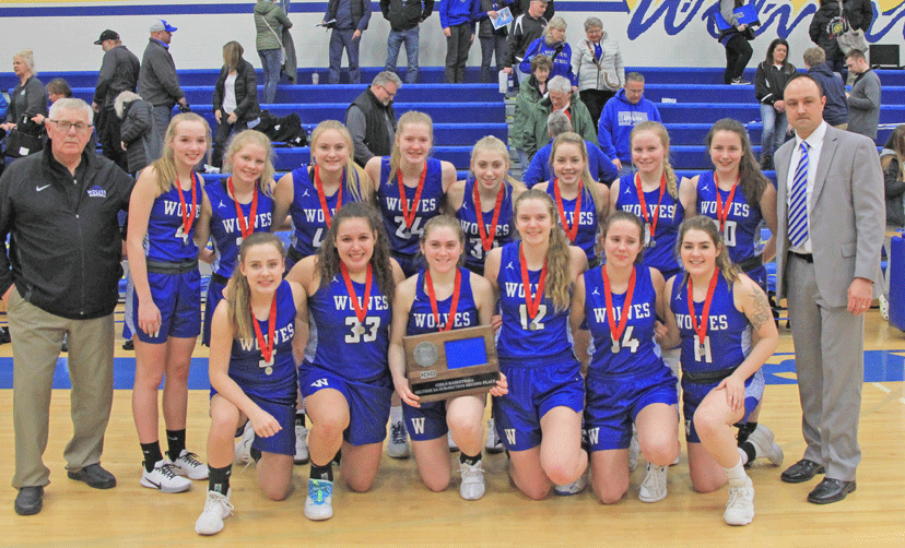 The WHA basketball team with the Section 5A West second-place trophy. The Wolves finish the season with a 27-3 record.