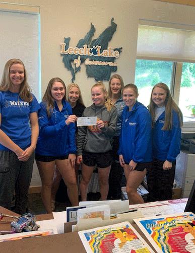 Pictured with their check are (from left) Megan Benjamin, Brianna Raddatz, Mackenzie Raddatz, Ally Sea, Katie Sagen, Rachel Pitt and Abi Strandlie.