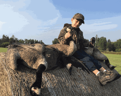 The author's grandson, Luke Talbot, with some early season geese.