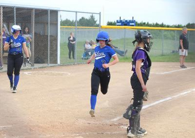 Elise Rice crosses home plate in WHA's home playoff win over Laporte last week while teammate Alexa Johannsen waits on deck.