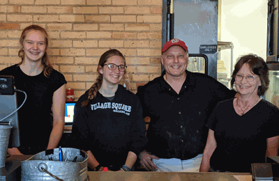 Village Square owner Gary Bilben and some of his staff.