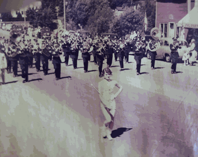 The Walker High School Band performing during a parade.