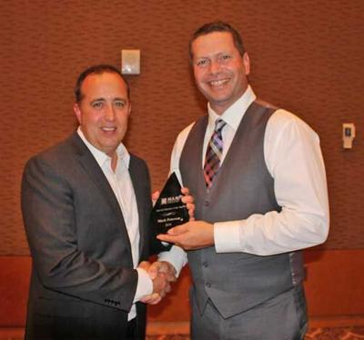 Mark Peterson receives the 2019 Assessor of the Year Award.