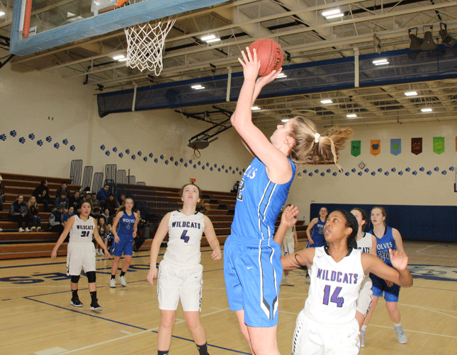 Megan Benjamin knocks down this bank shot in the Wolves' 105-32 home win over Laporte.