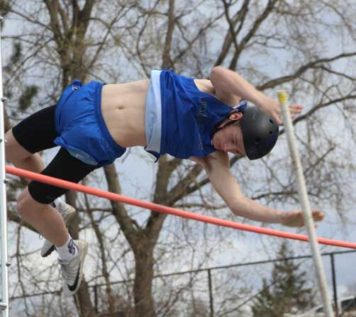 Zach Stevenson clears 11 feet on his way to a first-place finish in the pole vault.