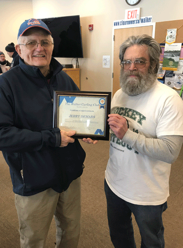 Jerry Demars (left) was presented with a certificate of appreciate for being an outstanding curling mentor and for his years of dedication, passion and hard work to the Walker Curling Club over the years. President Scott Spencer presented the recognition award, stating that Demars was responsible for bringing many of the current curling members into the club.