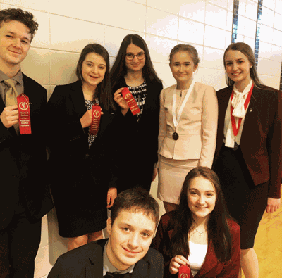Walker Talkers winning medals or ribbons were (front from left) Leo Burns, Lily Burns, (standing) Logan Wales, Sophia Landreville, Ada Muller, Willow Damar and Molly Massar.