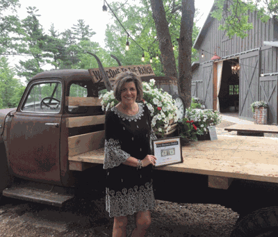 Julia Baird is pictured here with her First Business Dollar, presented by the Leech Lake Area Chamber of Commerce.