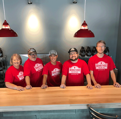 Pictured are from left) owners Sue and Doug Toth, nephew Jonathan Loftis, son Joseph Toth and nephew James Blomgren. Photo taken on opening day by Greg Pelkey, owner of GAP Refrigeration