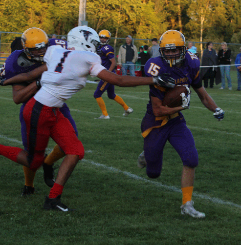 Gibson Smith uses a block by Chris McDougall to get by a Park Christian defender.