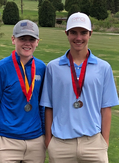 WhA golfers Parker Brock and Tanner Schneider with their Section 7A medals.