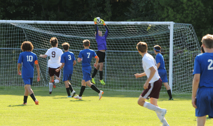 Josh Kuhlman makes a save in the Wolves' home game against Fergus Falls last week.