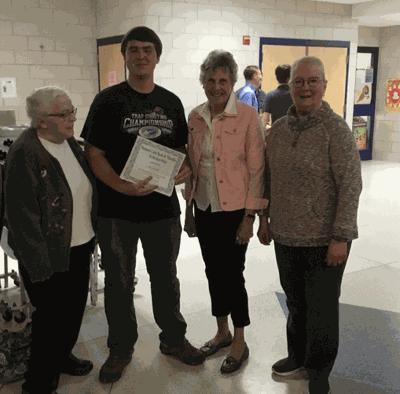 Pictured is Jacob Radke accepting the scholarship from (left) Margaret Zieffler, President Joni Kumpula and Gracee Rudkin.