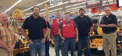 Pictured from left to right: Mike Mesia, Operations and Merchandise Manager; Del Matteson, Co-Owner; Mark Stish, Grand Rapids Power Equipment Department Head; Jeff Lindsay, Grand Rapids Store Manager; Eric Porterfield, Grand Rapids Store Assistant Manager; Shawn Matteson, Co-Owner; and Tim Stockstead, Cub Cadet Business Development Manager.