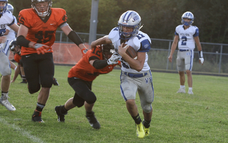 Steven Hausken sheds a tackle to pick up a nice gain on this second-half carry. Hausken finished the game with 100 yards rushing on 14 carries.