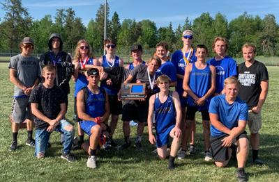 WHA boys' track and field team with the Subsection 29A trophy they won at Bagley School.