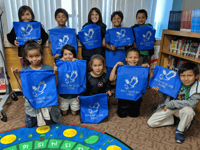 Pictured is the first-grade class with their new backpacks