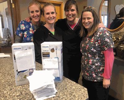 Pictured are dental hygenists (from left) Jackie Diekmann, Kayla Anderson, Jamie Roskamp and Kari Wood.