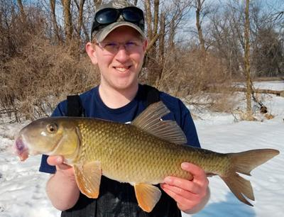 Ethan Rasset with new state record golden redhorse.