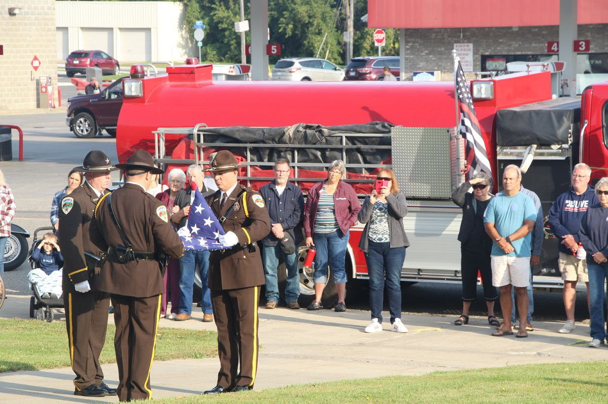 Members of the Cass County Sheriff's Honor Guard fold the American flag.