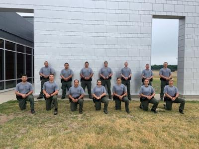 New conservation officers pictured are (front row from left) Ryan Brown, Corey Sura, Tou Vang, Leah Hennum-Stone, Cassie Block, Victoria Griffith, Chelsey Bechel, (back) Vincent Brown, Meng Moua, Stephen Westby, Charles Scott, Zach Larson, Michael Cross and Curt Simonson.