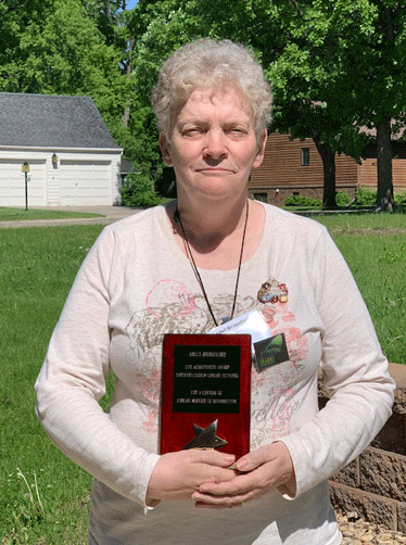 Adell Bridgeford with the distinguished Northern Lights Library Network Life Achievement Award.