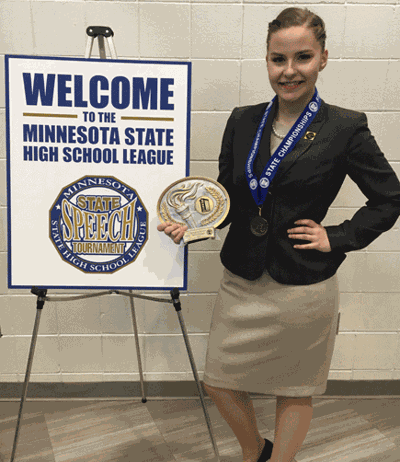 Hannah Kahlstorf with her first-place trophy at the Minnesota Class A State Speech Meet.
