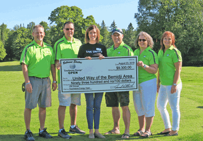 The Beltrami Electric Touchstone Energy Open Golf Tournament Committee present a check for $9,300 to the United Way of the Bemidji Area. Pictured are (from left) Jeff Noren, Rich Riewer, United Way Director Denae Alamano, Bob Gregg, Cammie Vogel and Angela Lyseng.