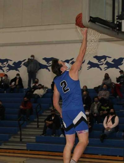 Clay Nelson scores two of his team-high 18 points against Red Lake on this steal and lay up.