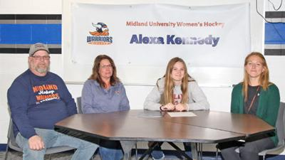 Alexa Kennedy (second from right) signed a letter of intent to play Division One hockey at Midland University. She is pictured with her parents, Jay and Barb Kennedy, and her high school coach, Rachel Landquist (right).