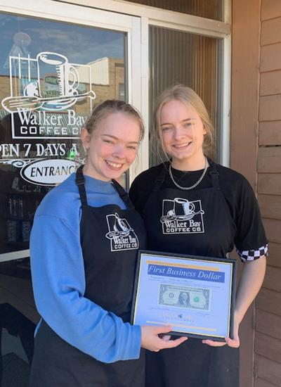 Hannah and Sara Burns (from left) are pictured with their First Business Dollar.