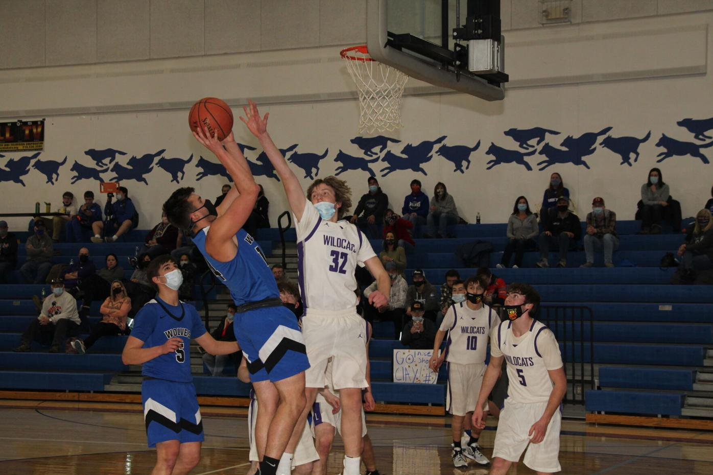 WHA's Carson Strosahl goes up for a first-half shot as Laporte's Zack Evans tries to block it.
