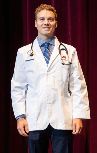 University of Minnesota-Duluth Medical School student Coleman Strosahl received his white coat during a special  ceremony.