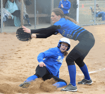 Emma Deegan slides safely into home in the third in the Wolves' win over Northome-Kelliher.