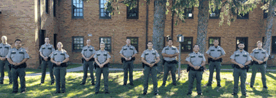 Graduates of Conservation Officer Academy 20 are (front row from left) Meng Moua, Victoria Griffith, Chelsey Bechel, Cassie Block, Tou Vang, and Ryan Brown, (back) Curt Simonson, Zach Larson, Michael Cross, Charles Scott, Stephen Westby, Vincent Brown and Corey Sura.